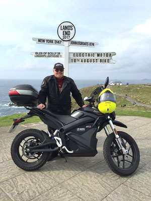 John Chivers and his Zero DSR electric motorcycle at Land's End.