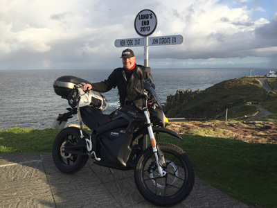 John Chivers and his Zero DSR electric motorcycle at Land's End. Official moment of departure.