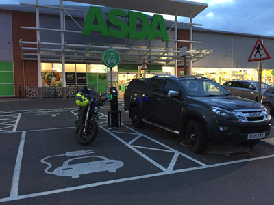 John Chivers' Zero DSR electric motorcycle charging at ASDA, Carlisle. The ISUZU looks like it probably doesn't need an electric charge.