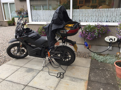John Chivers' Zero DSR electric motorcycle charging at Fendoch Guest House, Crieff.