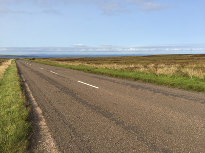 A99 approaching John O'Groats with Orkney on horizon.