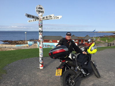 John Chivers and his Zero DSR electric motorcycle at John O'Groats.