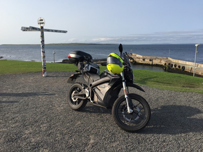 John Chivers' Zero DSR electric motorcycle at John O'Groats.