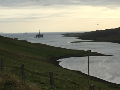 Old energy meets new energy. View from A970 near Shetland Golf Club.