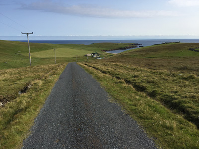 Approaching Skaw Beach and Britain's most northerly house on Unst, Shetland.