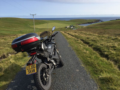John Chivers' Zero DSR electric motorcycle on the approach to Skaw Beach and Britain's most northerly house on Unst, Shetland.