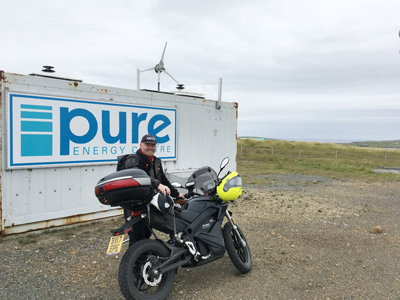 John Chivers' with his Zero DSR electric motorcycle at the Pure Energy Centre, Unst, Shetland.