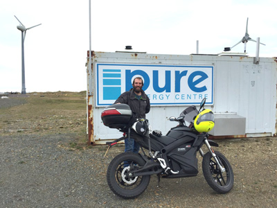 Ross Gazey of the Pure Energy Centre with John Chivers' Zero DSR electric motorcycle at the Pure Energy Centre, Unst, Shetland.
